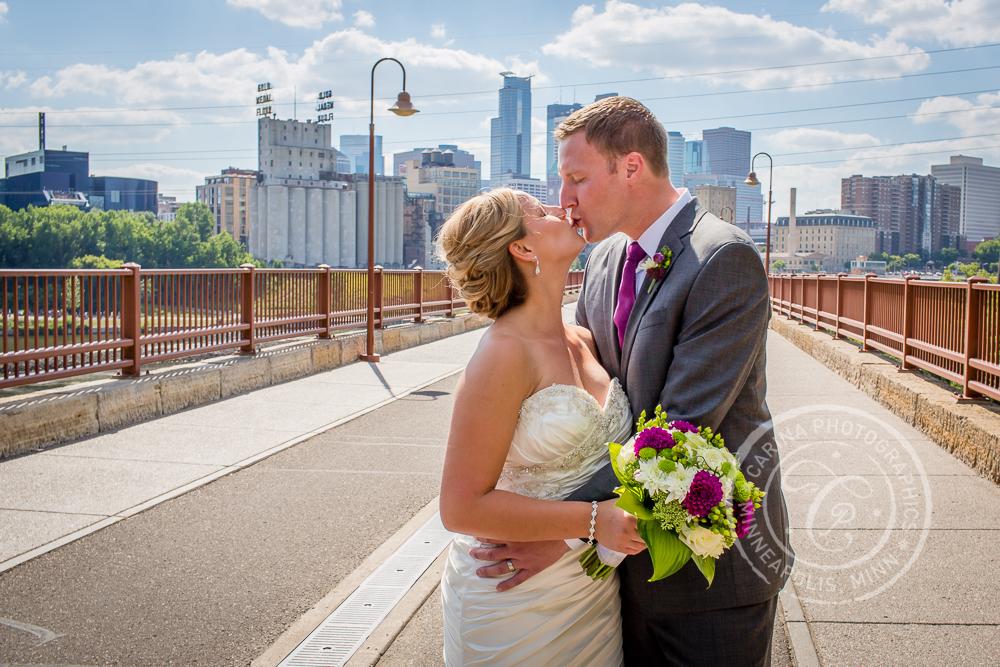 Minneapolis Stone Arch Bridge Wedding Bride Groom Kiss